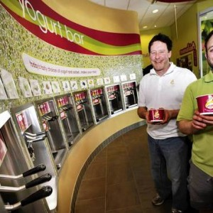 Richard Ryan, center, and his son Kevin Ryan pose at the yogurt bar at their new Menchie's in the Airport Center Shopping Center. The owners are the same people who opened that one at The Shops at Cedar Point in Allentown last year. (DONNA FISHER, THE MORNING CALL / April 9, 2013)