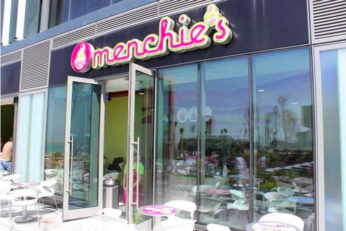An open door is ready to welcome guests into a Menchie's location.