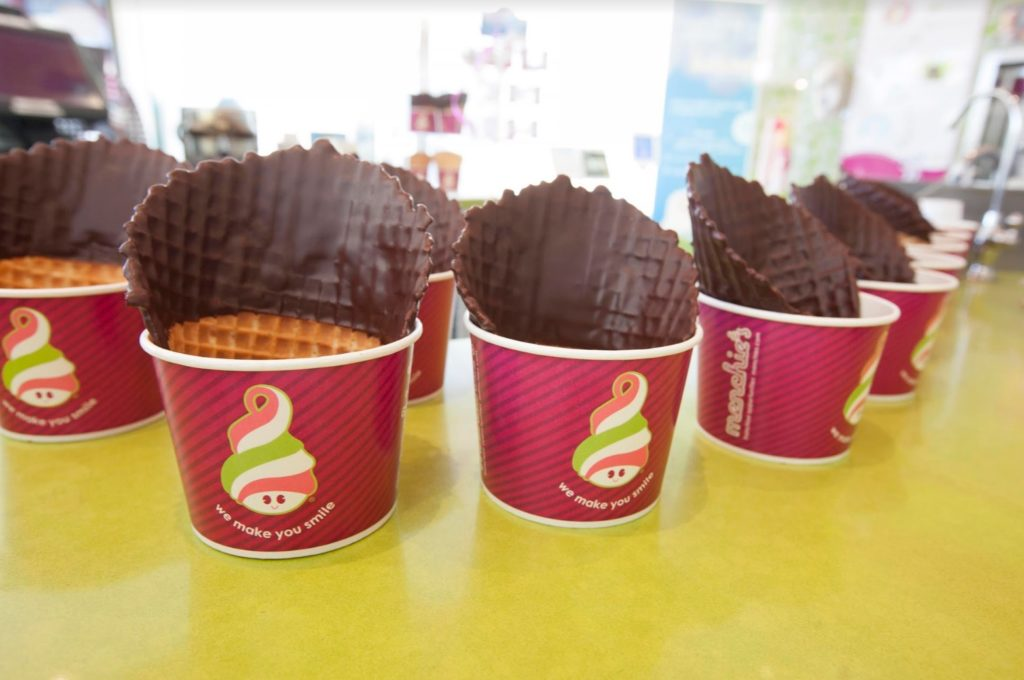 Dipped Waffle Cones lined up on a Menchie's counter top
