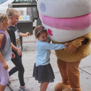 Children hug the Menchie's mascot in our Sherman Oaks, CA, location.